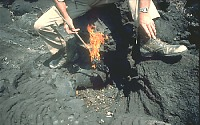 Burning torch on end of stick, Nyamuragira Volcano, Zaire
