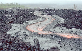 Active lava channel on surface of `a`a flow, Kilauea Volcano,      Hawai`i