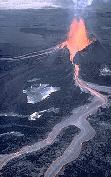 Lava fountain and `a`a flow erupt from Pu`u `O`o vent, Kilauea Volcano