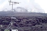 HVO scientists working on gas-monitoring stations, Kilauea Volcano, Hawai`i