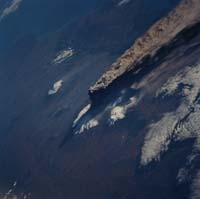 View of an eruption cloud at Klyuchevskoi volcano, Russia, from the space shuttle