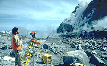 Scientist at EDM station on crater floor, Mount St. Helens