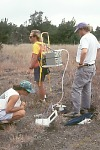 Scientists using chamber and analyzer at Puhimau thermal area, Kilauea Volcano