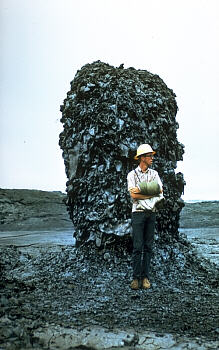 Hornito on pahoehoe flow with person for scale, Kilauea Volcano, Hawai`i