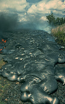 Thin pahoehoe flow advancing on road, Kilauea Volcano, Hawai`i