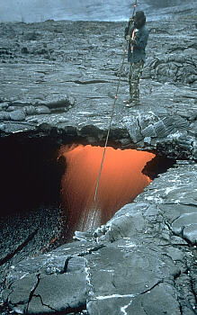 Lava tube skylight with person for scale, Kilauea Volcano, Hawai`i