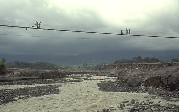 Photo of footbridge crossing Rio Nima II near El Palmar, Guatemala