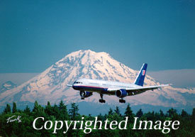 Jet aircraft landing in Seattle, Washington, Mount Rainier in background