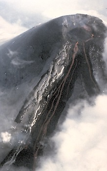 Lava pouring through notch in summit crater, Villarrica Volcano, Chile
