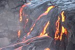 Lava pours over lip of Wilipea sea cliff, Mother's Day flow, Kilauea volcano, Hawai`i