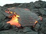 Lava breaks out from side of crusted flow, Kilauea volcano, Hawai`i