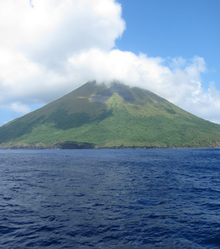 Asuncion Island volcano photo by Annette DesRochers of NOAA.