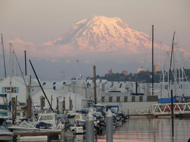 Mount Rainier rises above Tacoma, Washington and boat harbor, which may be impacted during the next eruption of the volcano.