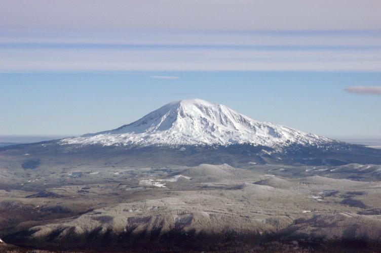 Mount Adams, Washington as seen from Mount St. Helens (west).  Trees are covered in frost in the foreground.