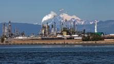 Mount Baker in the background of the Tesoro oil refinery in Padilla Bay, Washington. Volcanic hazards from Mount Baker such as ash fall could impact this refinery during a future eruption.