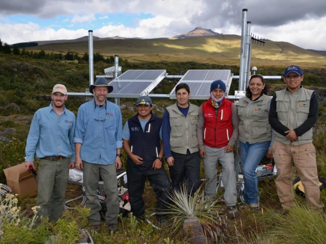 Volcano Disaster Assistance scientists working with colleagues from the Instituto Geofisico in Bocatoma, Ecuador to install a lahar monitoring station during the July 2015 Cotopaxi eruption response.