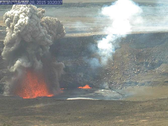 A small explosion from KILAUEA's summit lava lake in April 2015 was triggered by a rock fall from the HALEMAUMAU Crater wall. This image was recorded by a webcam in the HVO observation tower.