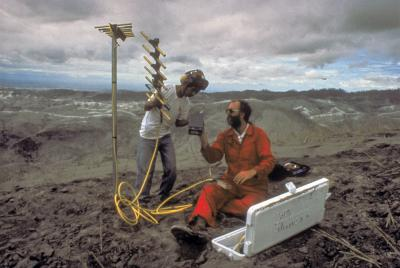 Scientists from the U.S. and Philippines install a new seismic station after 15 June 1991 eruption of Mount Pinatubo, Philippines. (Click image to view full size.)