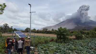 A telemetered, solar-powered scanning spectrometer was installed in 2016 at Sinabung Volcano in Sumatra, Indonesia. It measures sulfur dioxide gas emissions, which helps forecast volcanic activity.  (Click image to view full size.)