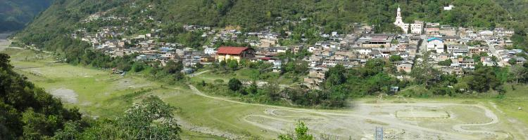 Panoramic image of Belacázar Village eight years after the 2008 lahar innundation. Lahar deposits in the foreground of the town are now soccer fields and a dirt bike track. (Click image to view full size.)