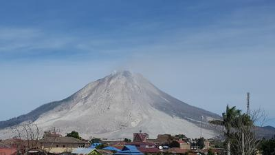 Sinabung Volcano, Indonesia. Fresh eruption deposits visible on the flanks. Photo taken between small explosive events in 2016. (Click image to view full size.)
