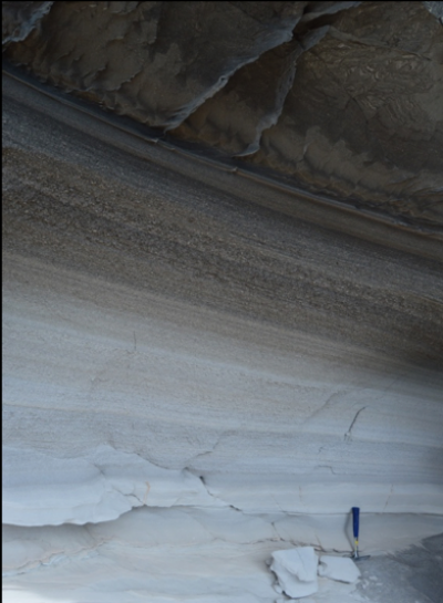 Huckleberry Ridge Tuff exposed on Mount Everts, with light colored ash on the bottom changing to dark, welded ignimbrite above. (Click image to view full size.)