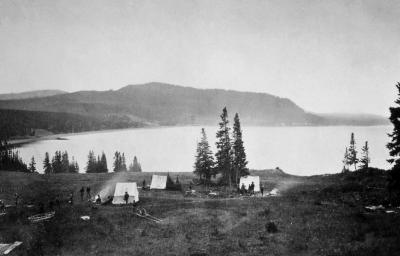 """Earthquake camp"" of the Hayden expedition in 1871, located on the north shore of Yellowstone Lake near Steamboat Point. (Click image to view full size.)"