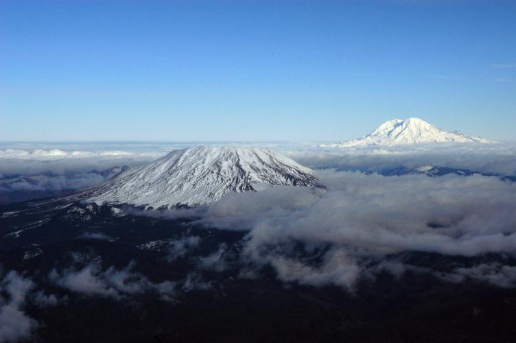 Mount St. Helens and Mount Rainier, aerial view toward the north.