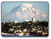 Mount Rainier as a backdrop behind the city of Tacoma, WA.