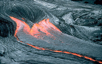 Close view of lava moving across the ground, Kilauea Volcano, Hawai`i